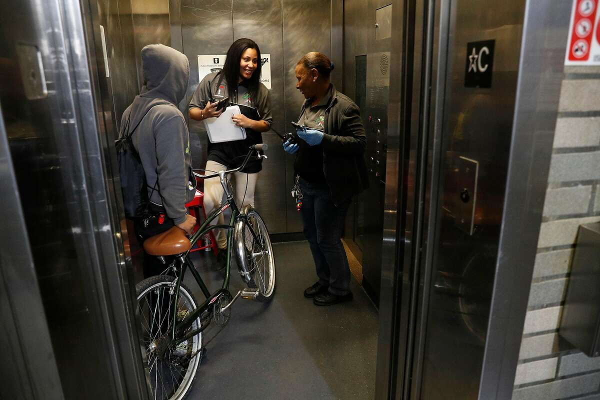 Shauna Adams, (left) takes over for Theresa Phillips who is taking a break while the two work as new BART elevator attendants at the Civic Center station in downtown San Francisco, Ca. on Mon. April 30, 2018.