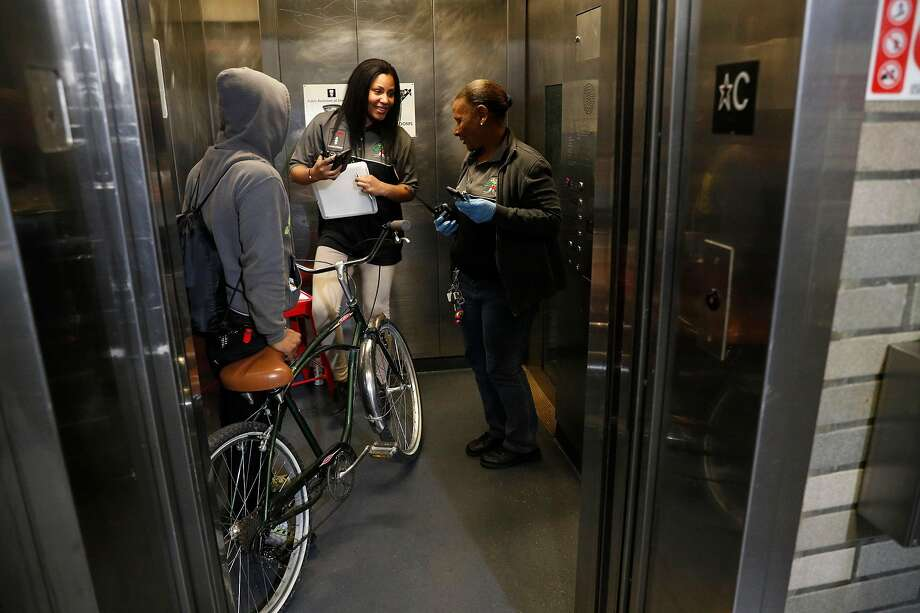 Shauna Adams, (left) takes over for Theresa Phillips who is taking a break while the two work as new BART elevator attendants at the Civic Center station in downtown San Francisco, Ca. on Mon. April 30, 2018. Photo: Michael Macor / The Chronicle