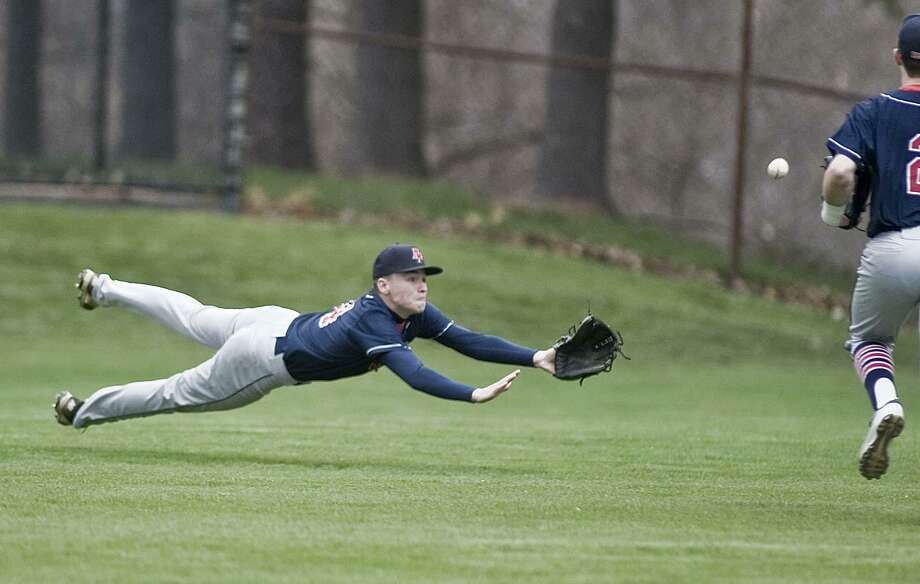 New Fairfield High School left fielder Matt Garbowski dives for a fly ball in a game against Bethel High School, played at Bethel. Monday, April 30, 2018 Photo: Scott Mullin / For Hearst Connecticut Media / The News-Times Freelance