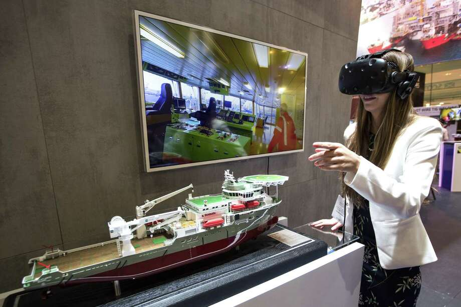Jessica Bertsch takes a virtual tour of Boka Atlantis, dive support vessel, at the Boskalis booth during the 50th Offshore Technology Conference on Monday, April 30, 2018, in Houston. ( Brett Coomer / Houston Chronicle ) Photo: Brett Coomer, Staff / Houston Chronicle / © 2018 Houston Chronicle