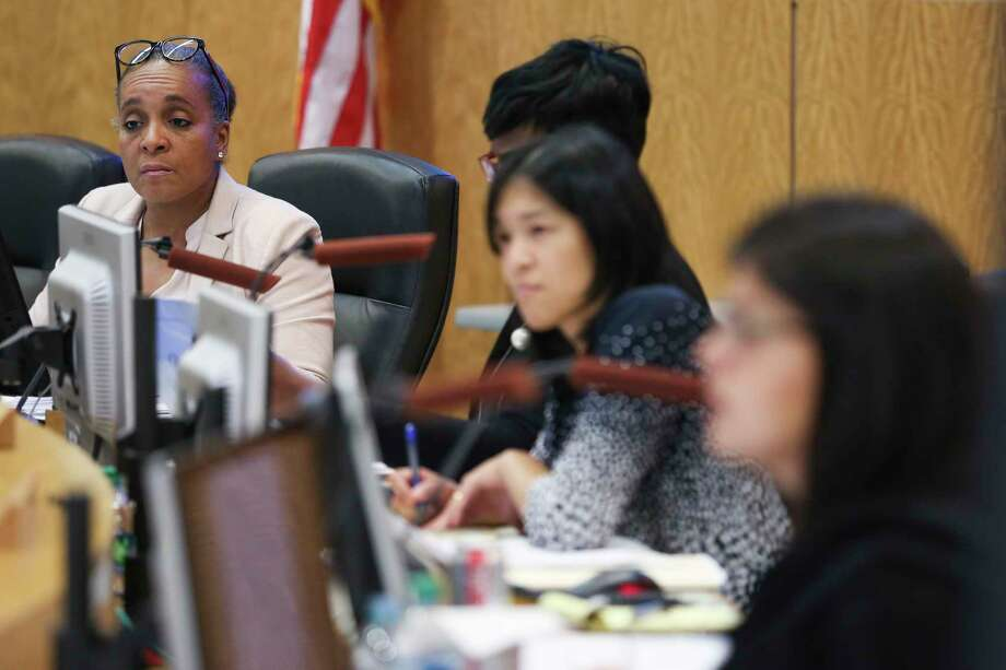 In this April file photo, Houston ISD Board of Education President Rhonda Skillern-Jones, left, listens during an agenda review meeting. Trustees unanimously approved the district's $2 billion 2018-2019 budget Monday. Photo: Michael Ciaglo, Houston Chronicle / Michael Ciaglo