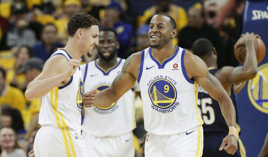 Golden State Warriors' Andre Iguodala and Klay Thompson smile in the third quarter during game 1 of round 2 of the Western Conference Finals between the Golden State Warriors and the New Orleans Pelicans at Oracle Arena on Saturday, April 28, 2018 in Oakland, Calif. Photo: Carlos Avila Gonzalez / The Chronicle / online_yes