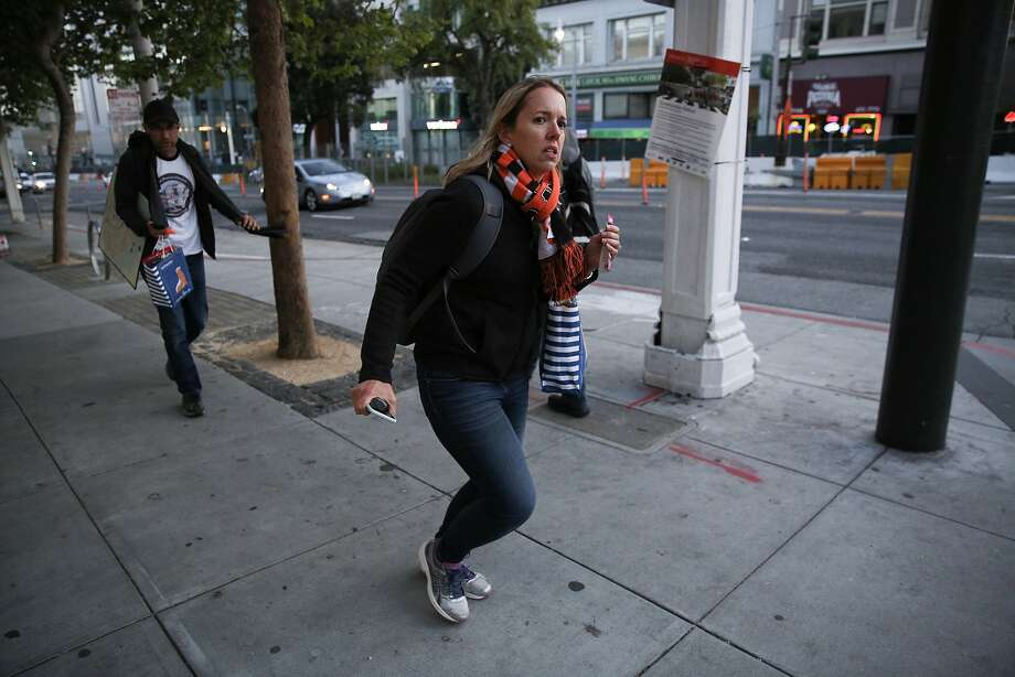 From left: Peter Hartlaub and Heather Knight run to make it to the 3 Jackson bus at Van Ness Avenue and Sutter Street, Monday, April 30, 2018, in San Francisco, Calif. Photo: Santiago Mejia, The Chronicle
