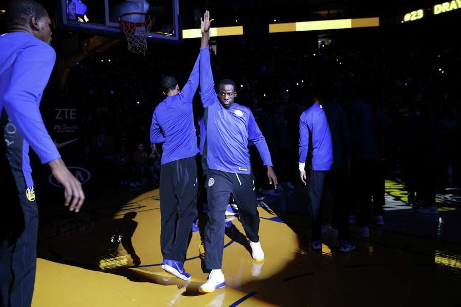 Golden State Warriors' Draymond Green high-fives Shaun Livingston during pregame introductions prior to a game against the Denver Nuggets at the Oracle Arena on Saturday, September 30, 2017. Photo: Santiago Mejia / The Chronicle / ONLINE_YES