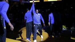 Golden State Warriors' Draymond Green high-fives Shaun Livingston during pregame introductions prior to a game against the Denver Nuggets at the Oracle Arena on Saturday, September 30, 2017.