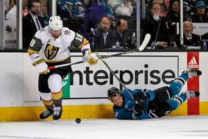 Brenden Dillon (4) can only watch as James Neal (18) makes off with the puck in the second period as the San Jose Sharks played the Vegas Golden Knights in Game 1 of the second round of the NHL Stanley Cup Playoffs at SAP Center in San Jose, Calif., on Monday, April 30, 2018.