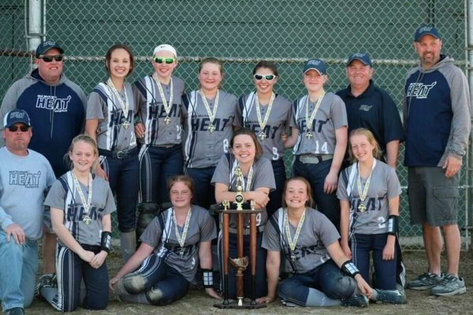 The Mid-Michigan Heat team is pictured above:(front row, from left) Coach Cantrell, Maddie Cantrell, Alexis Grove, Grace Davis, Emma Swarthout, Hattie Veenkant; (back row, from left) Coach Veenkant, Maddy Travis, Kate Pnacek, Savannah Robinson, Taylor Huschke, Sawyer Gerow, Coach Robinson, Coach Travis.