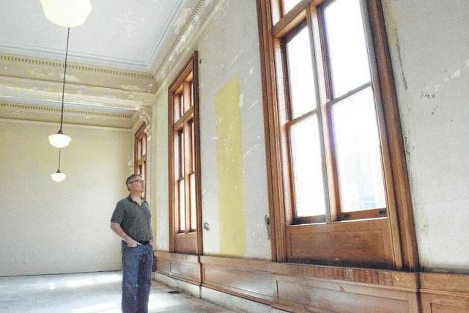 David Blanchette, chairman of the Jacksonville Heritage Cultural Center board, looks at one of the rooms in the former Jacksonville Post Office building, which is being renovated to house the Jacksonville Area Museum. Photo:       Greg Olson | Journal-Courier