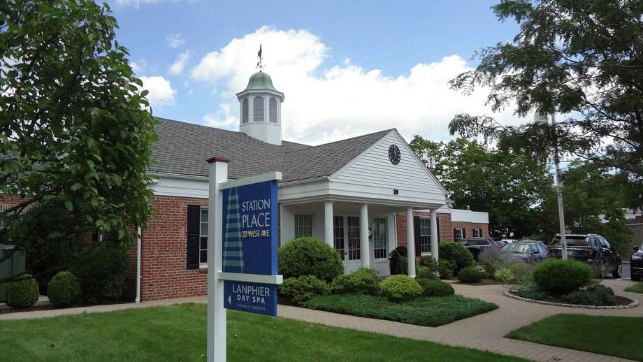 The Station Place headquarters of Genesee & Wyoming at 20 West Ave. in Darien, Conn., opposite the town's Metro-North stop. On August 15, 2016, G&W announced an agreement to acquire Providence and Worcester Railroad, giving it access to Amtrak and Metro-North tracks. Photo: Alexander Soule / Hearst Connecticut Media / Stamford Advocate