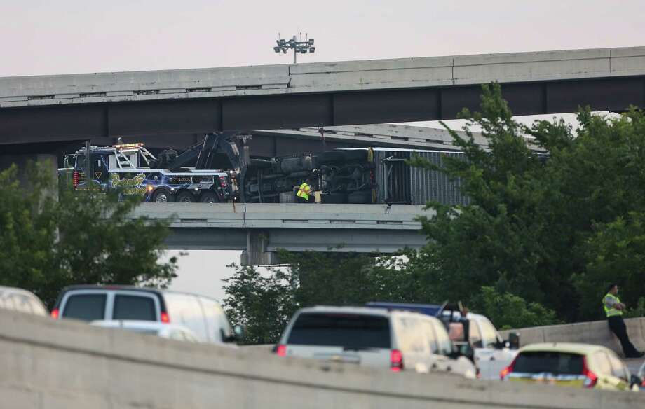 An overturned 18-wheeler blocks the 610 West on ramp off the Eastex Freeway Tuesday, May 1, 2018, in Houston. Photo: Godofredo A. Vasquez, Houston Chronicle