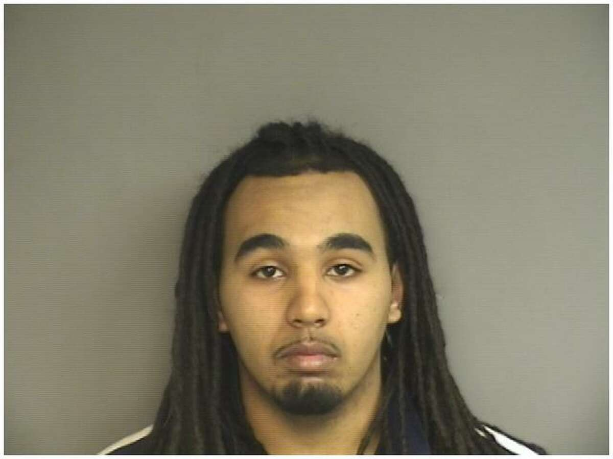 Morris Joel Moore, 23, of Stamford, was arrested for conspiracy to murder a 43-year-old woman who was shot to death at Lione Park Monday night.