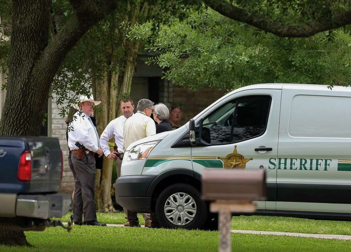 Authorities investigate the scene where a man was shot and killed as League City Police Department Combined Agency Response served a warrant on the 300 block of Morningside Drive Tuesday, May 1, 2018, in League City, Texas.