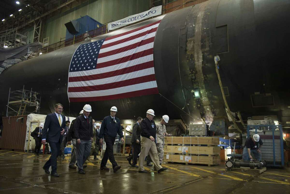 Former U.S. Secretary of Defense Ash Carter tours the General Dynamics Electric Boat facility in Groton, Conn., in May 2016.