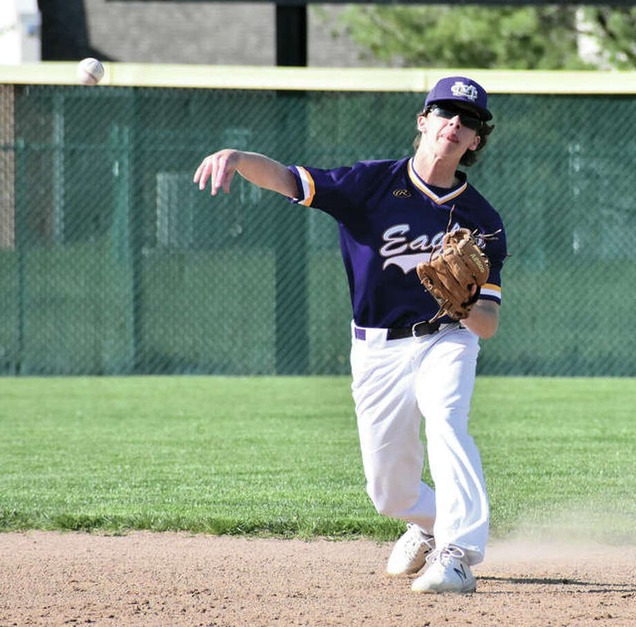 CM second baseman Keaton Loewen throws to first for an out during the Eagles game Friday against the Tigers at Tom Pile Field in Edwardsville. The Eagles returned to MVC play Monday and fell to Mascoutah at the Bethalto Sports Complex. Photo:       Matthew Kamp / Hearst Newspapers