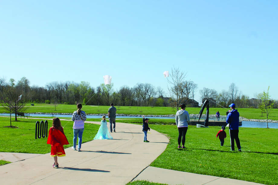 Children and their parents fly kites Saturday morning at Glik Park as part of the Edwardsville Park and Recreation Department's annual Flying 4 Kids Kite Fly. The event, which made free kites available, was sponsored by Cassens Transport and featured a demonstration and instruction by members of the Gateway Kite Club. Intelligencer photo by Bill Tucker.