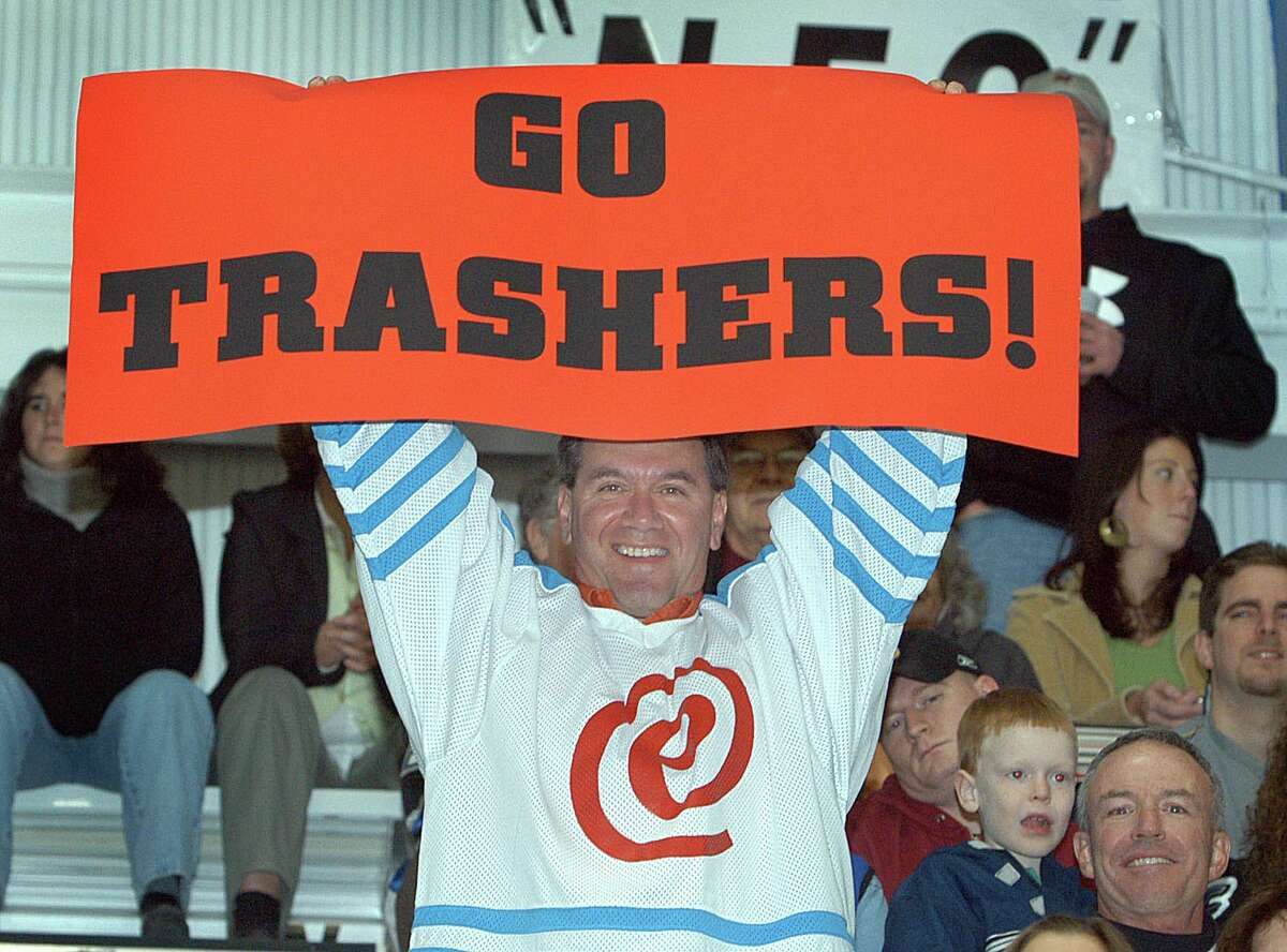 Nino Desposati of Danbury holds up a sign at the Trashers game Oct. 18, 2005