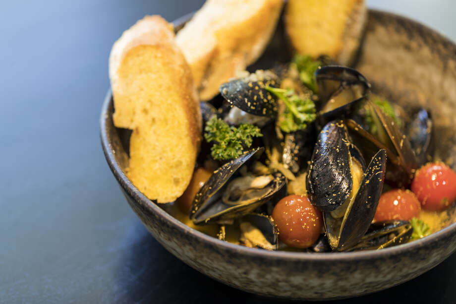 Mussels a la plancha, a dish from chef Dominick Lee at Poitin, a new restaurant opening May 14 at 2313 Edwards at Sawyer Yards.