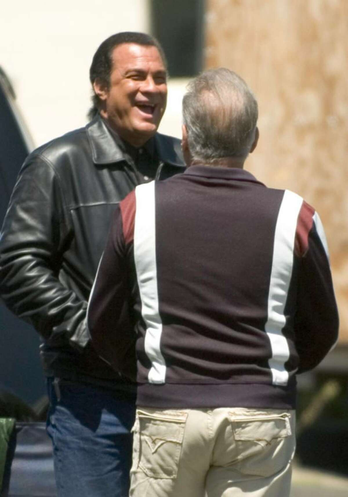 Steven Seagal, left, speaks with actor, Arthur J. Nascarella, right, during filming of Marker, a Steven Seagal film in downtown Stamford, Conn. on Monday, May 7, 2007.