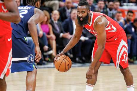 Houston Rockets guard James Harden (13) dribbles down the court as the Houston Rockets take on the Minnesota Timberwolves in the first half of Game 4 of the first round of the NBA Playoffs at Target Center Monday, April 23, 2018 in Minneapolis.