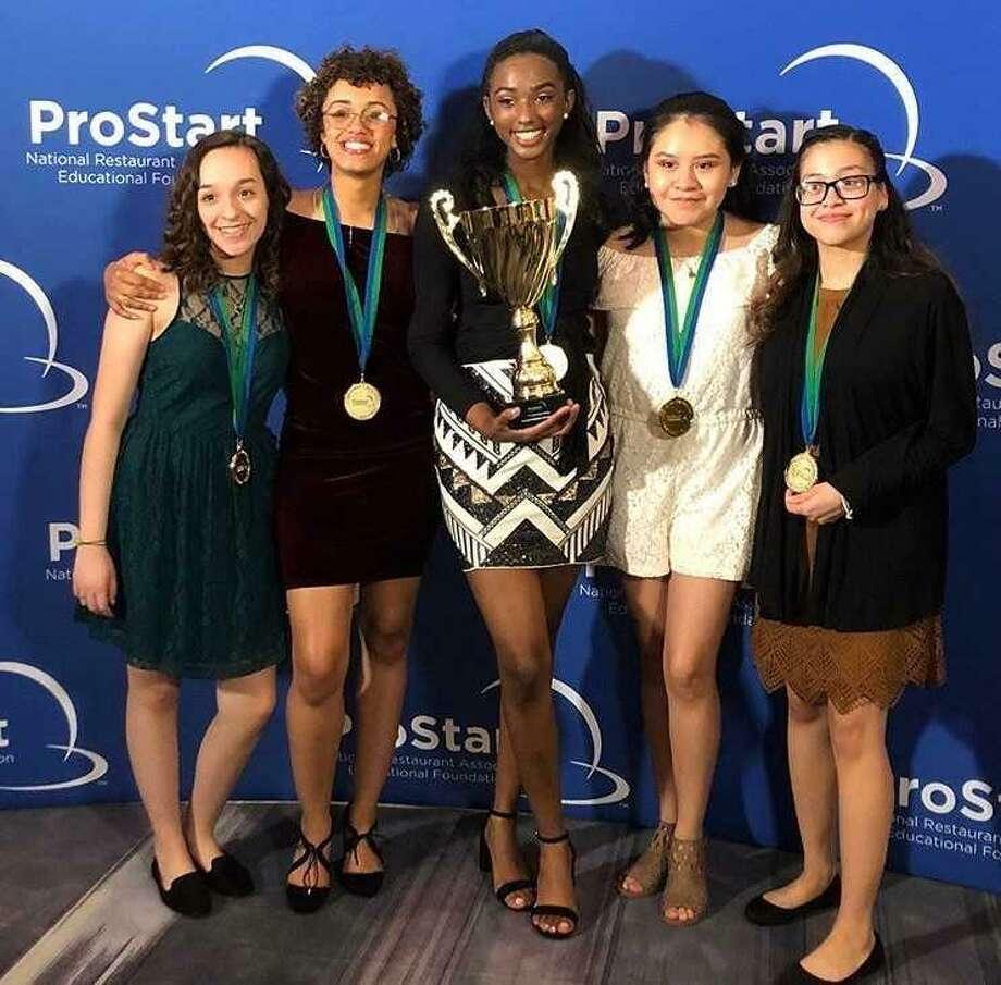 The national competition winning team from Wilbur Cross, from left,Brenda Lituma, Denaysia Gumbs, team Capt. Janaisha Taylor, Eva Perez and Kayla Rose. Photo: Contributed Photo