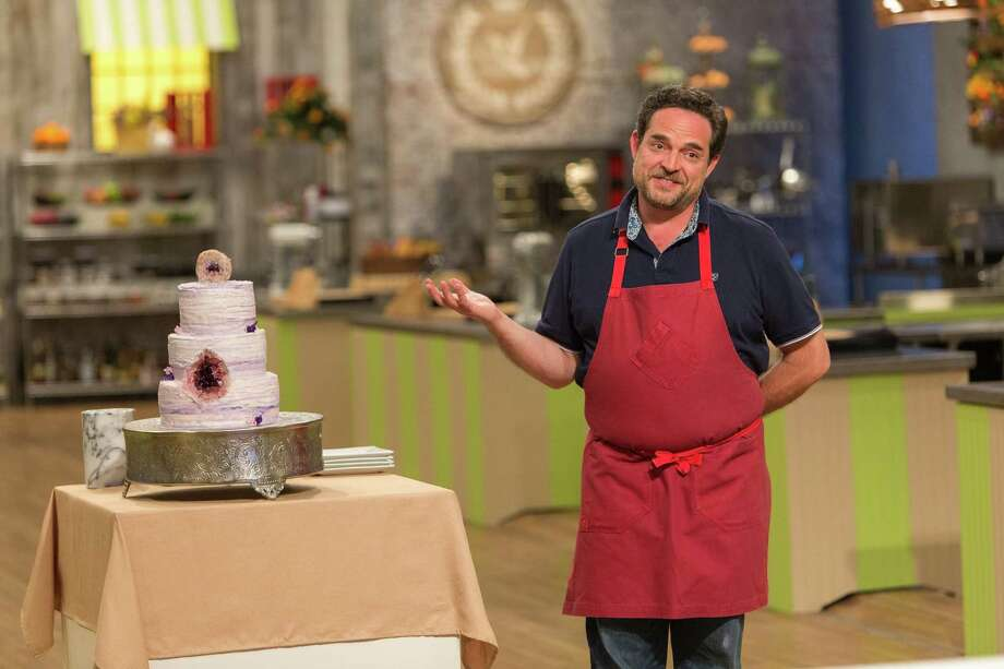 "San Antonio chef Nacho Aguirre shows off the geode cake that won him the title on Food Network's ""Spring Baking Championship."" Like unicorn cakes, geode cakes are all the rage these days in cake art. Photo: Courtesy Food Network / © 2017, Television Food Network, G.P. All Rights Reserved."