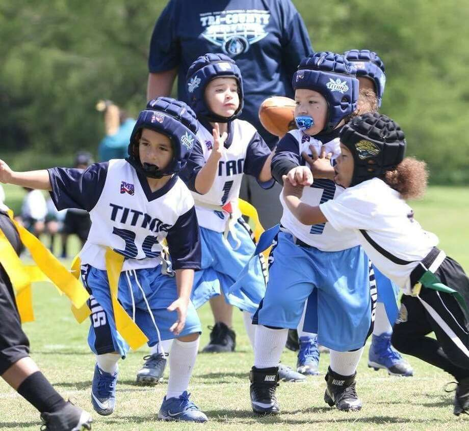 From left, Tyler Tapia, Aiden Franco and Mason Milner play in a Texas Youth Football Association game. (Courtesy Flo's Photography)  Photo: Courtesy Flo's Photography