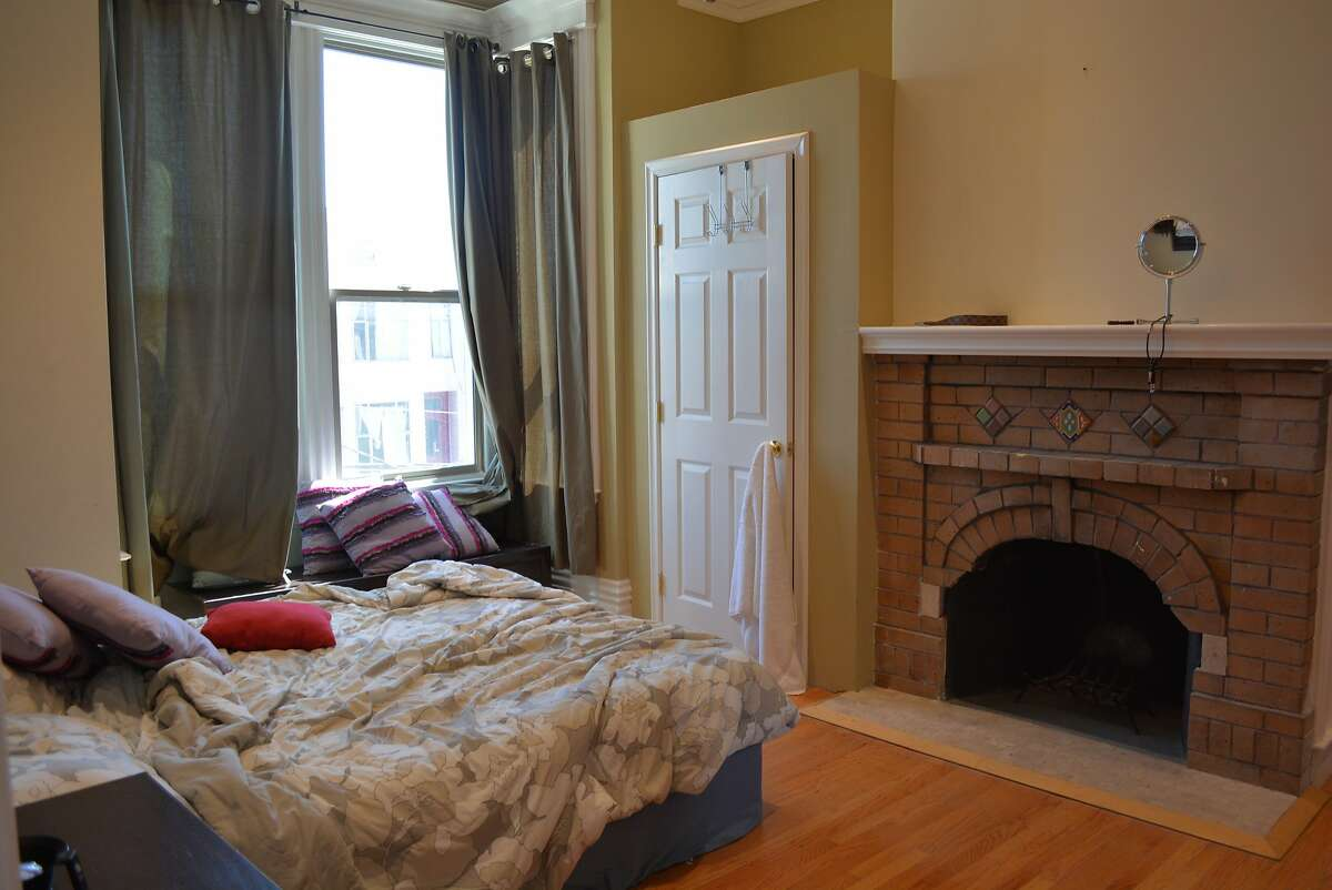 Valerie and Darren Lee illegally rented multiple San Francisco properties on Airbnb, according to a court motion. When city investigators visited the units, they were staged to appear as if tenants lived there -- but all had almost identical staging, the motion said. This bedroom at 1362-1364 Utah with its distinctive fireplace and layout, is shown in photos taken by city investigators, as well as in its Airbnb listing.