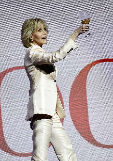 "Jane Fonda, 80, toasts the audience at a Las Vegas event. She stars in ""Book Club,"" opening Friday, May 18. Photo: Chris Pizzello / Invision"