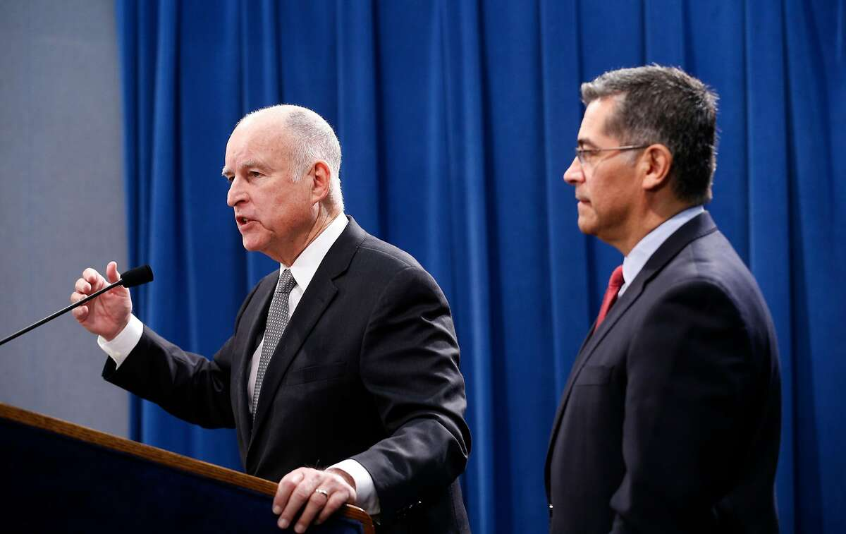 California Governor Edmund G. Brown Jr.(left) joins Attorney General Xavier Becerra at a press conferenceat the State Capitol in Sacramento, Calif. on Wed. March 7, 2018, to discuss U.S. Attorney General Jeff Sessions� decision to sue the State of California.