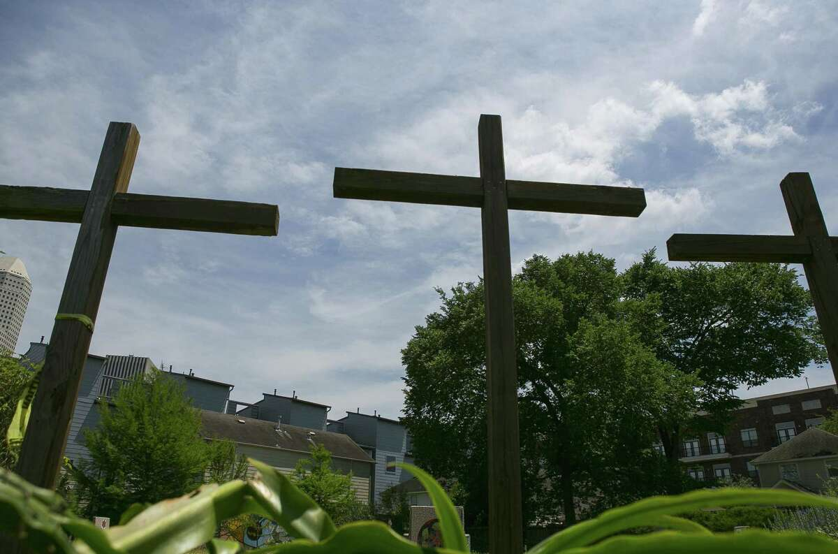 Crosses mark the site of the former Mt. Carmel Missionary Baptist Church where the Historic Freedman's Town Labyrinth now sits, Sunday, April 29, 2018, in Houston. The labyrinth is a variation of a design laid in 1201 in the knave of the Chartres Cathedral in France. The church was demolished by the city after being deemed unsafe in 2008. ( Mark Mulligan / Houston Chronicle )