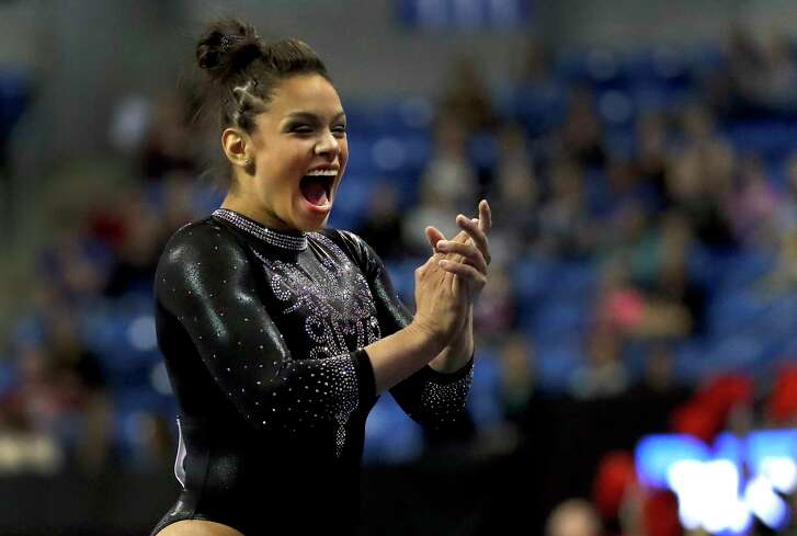 Georgia's Sabrina Vega applauds after competing in the floor exercise during the NCAA college women's gymnastics championships Friday, April 20, 2018, in St. Louis. (AP Photo/Jeff Roberson)