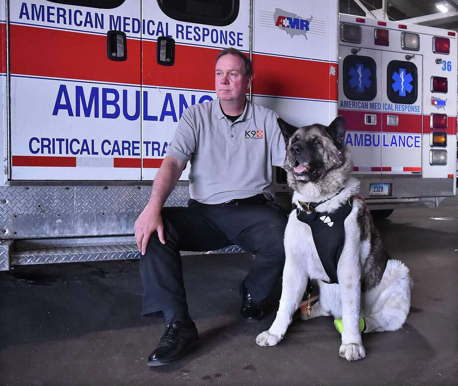 Milford resident Brad Cole, of K9 First Responders with his therapy dog, Spartacus Chooch, a 9-year-old American Akita at American Medical Response on Middletown Avenue in New Haven, Saturday. Photo: Catherine Avalone / Hearst Connecticut Media / New Haven Register