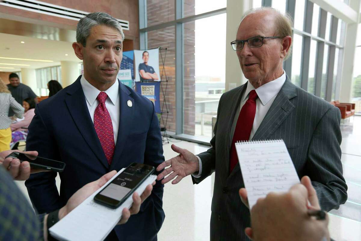 San Antonio Mayor Ron Nirenberg, left, and Bexar County Judge Nelson Wolff talk with reporters in May 2018. Nirenberg and Wolff started a daily briefing to update the public on the coronavirus pandemic..