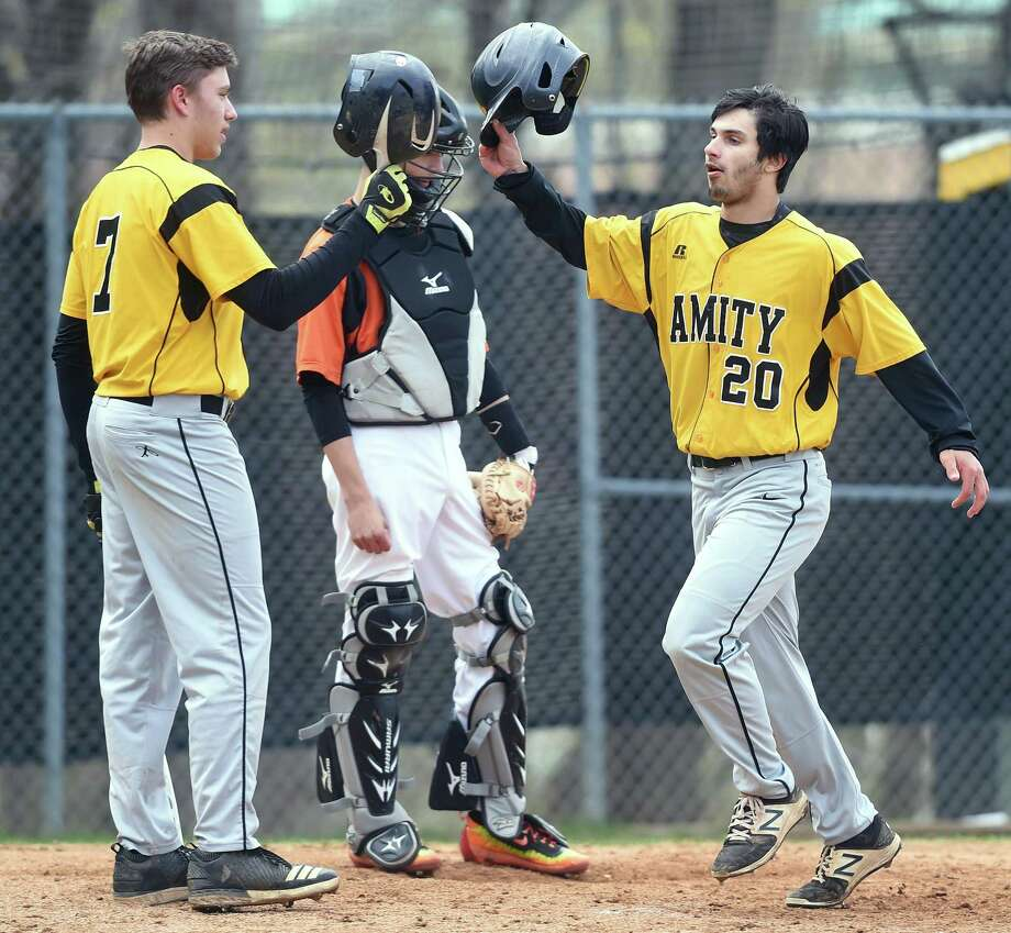 Amity's John Lumpinski, left, congratulates Jared Smith after his first of two home runs against Shelton on Monday. Photo: Arnold Gold / Hearst Connecticut Media / New Haven Register