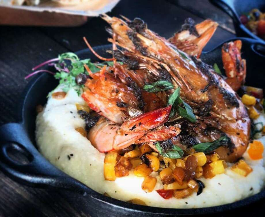 Whole jerk shrimp in smooth buttermilk grits topped with a fresh roasted corn maque choux will be one of the signature dishes at The Jerk Shack, which will open on May 11 at 117 Matyear St. Photo: Courtesy Photo