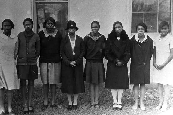 Artemisia Bowden, in hat, with a group of students at St. Philip's.