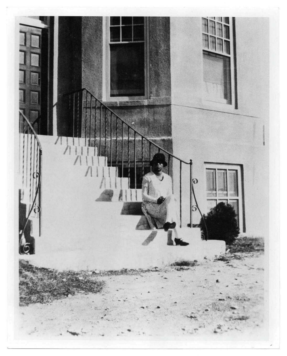 Artemisia Bowden is seen standing in an undated photo provided by St. Philips on the steps of the Johnston Memorial Building on the St. Philip's campus