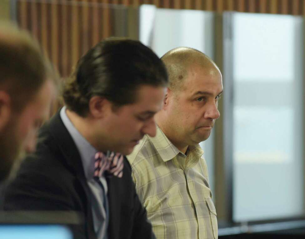 Mark Kirker, right, a former Glenville police officer, appears in Albany City Court to respond to charges related to alleged falsifying records during his time as a Glenville police officer, on Tuesday, May 1, 2018, in Albany, N.Y. Kirker is currently a deputy with the Schenectady County sheriff's office. (Paul Buckowski/Times Union)