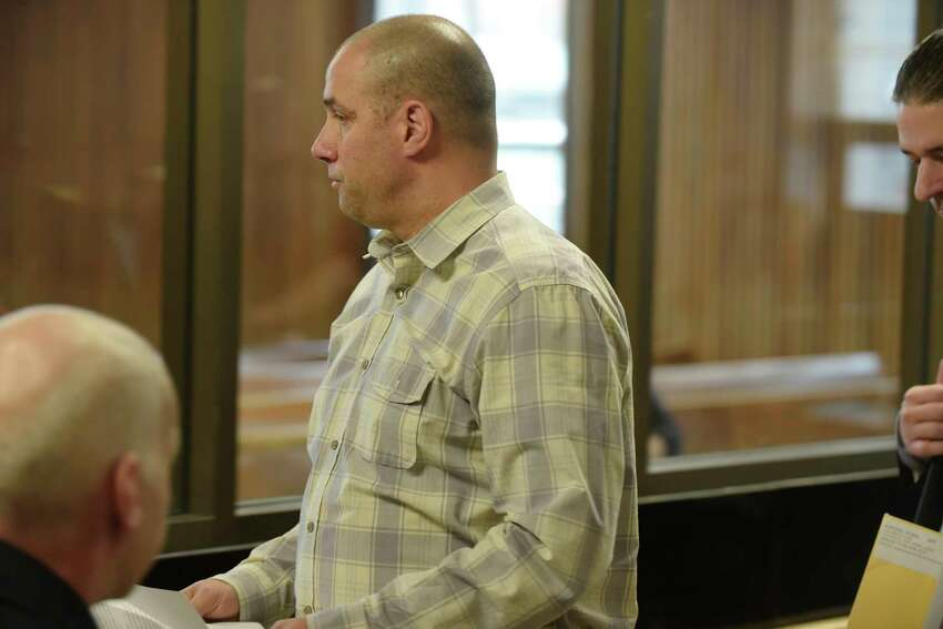 Mark Kirker, a former Glenville police officer, appears in Albany City Court to respond to charges related to alleged falsifying records during his time as a Glenville officer, on Tuesday, May 1, 2018, in Albany, N.Y. Kirker is currently a deputy with the Schenectady County sheriff's office. (Paul Buckowski/Times Union)