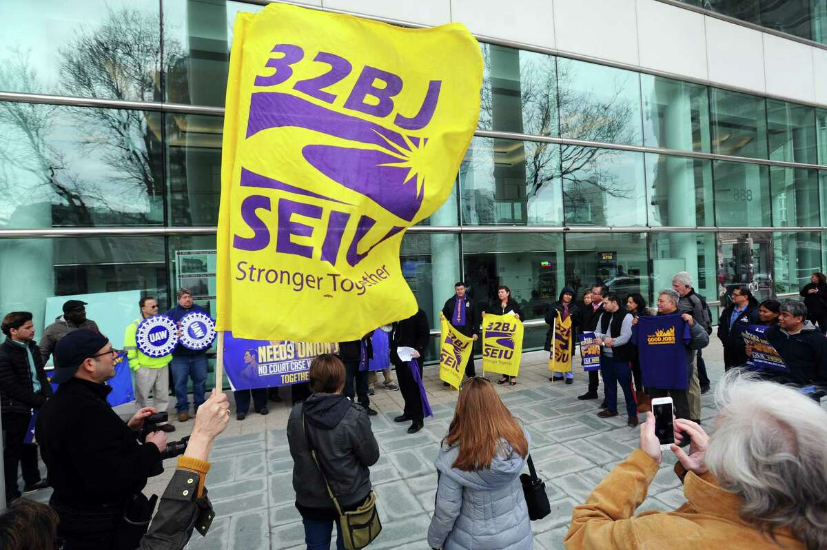 Local workers stand up for their freedom to fight for decent and equitable pay during a rally outside of Government Center in downtown Stamford, Conn. on Monday, Feb. 26, 2018.