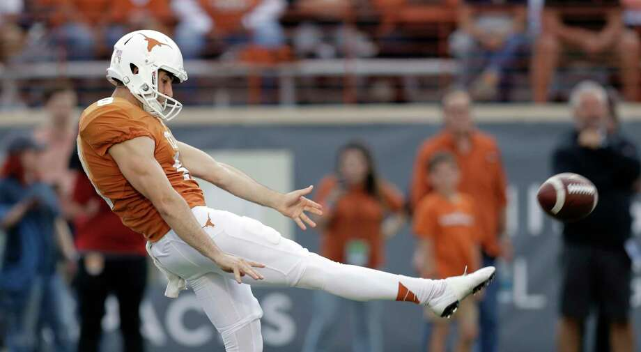 Texas' Ryan Bujcevski will try to follow in the steps of his cousin, Michael Dickson, was one of Texas' key players last season at punter. Photo: Eric Gay, Associated Press / Copyright 2018 The Associated Press. All rights reserved.