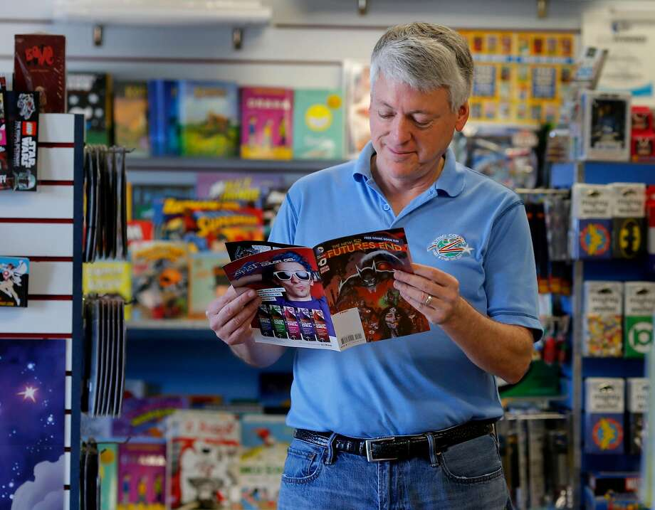 Joe Field looks over one of the comics that will be given away on Free Comic Book Day in Concord. Photo: Brant Ward / The Chronicle