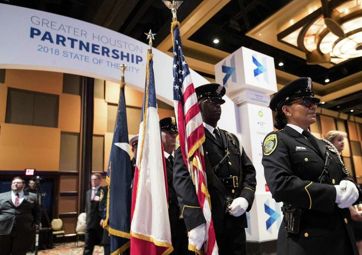 A Houston Police honor guard readies to post the colors before during the State of the City address, presented by the Greater Houston Partnership, on Tuesday, May 1, 2018, in Houston. ( Brett Coomer / Houston Chronicle )
