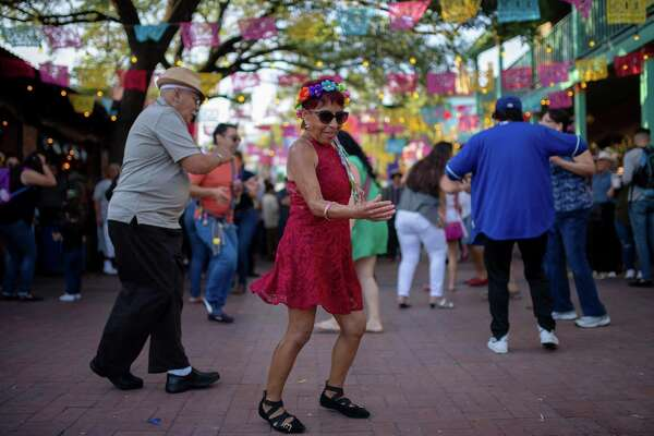 San Antonio photographer Erik Gustafson went to Market Square to take pictures of Fiesta revelers. Here are some he captured.