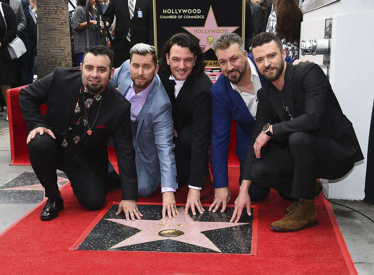 Chris Kirkpatrick, from left, Lance Bass, JC Chasez, Joey Fatone and Justin Timberlake of the band NSYNC appear at a ceremony honoring them with a star on the Hollywood Walk of Fame April 30, 2018, in Los Angeles. Kirkpatrick will host the Alton River Dragons versus Cape Girardeau Thursday during '90s Night. (Photo by Jordan Strauss/Invision/AP)