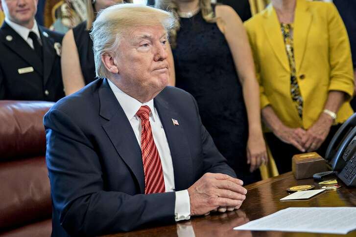 U.S. President Donald Trump listens while meeting with the crew and passengers of Southwest Airlines Co. flight 1380 in the Oval Office of the White House in Washington, D.C., U.S., on Tuesday, May 1, 2018. An engine on Southwest's flight 1380, a Boeing Co. 737-700 bound for Dallas from New Yorks LaGuardia airport, exploded and made an emergency landing on April 17 sending shrapnel into the plane and killing a passenger seated near a window. Photographer: Andrew Harrer/Bloomberg