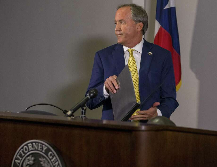 Texas Attorney General Ken Paxton prepares to announce his lawsuit against the federal government to end the Deferred Action for Childhood Arrivals (DACA) at his office in downtown Austin, Tuesday, May 1, 2018. On Friday, he filed a lawsuit against San Antonio police and the City of San Antonio. Photo: Stephen Spillman /Stephen Spillman / stephenspillman@me.com Stephen Spillman