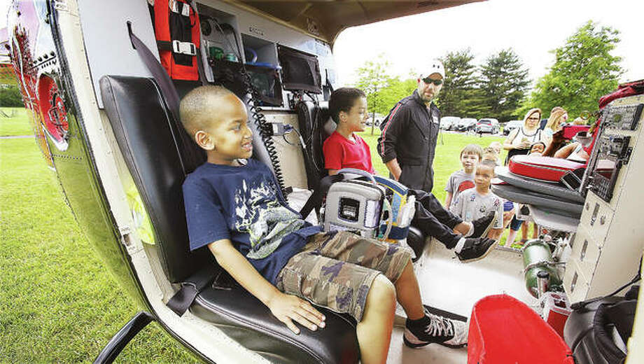 It wasn't exactly a truck, but children seemed to have a blast climbing into the flight nurse seats of the Survival Flight helicopter ambulance, which was on display at last year's Big Truck Day event in Godfrey's Glazebrook Park. This year's event will be Wednesday, May 9. Photo:       John Badman | The Telegraph