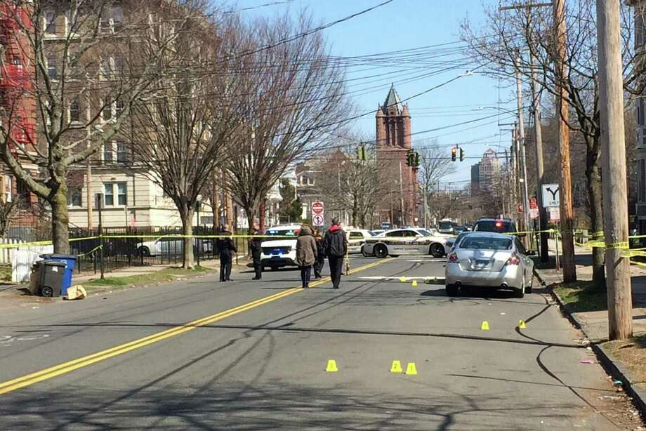 Police and emergency personnel responded to a fatal shooting on Chapel Street between Winthrop Avenue and Norton Street in New Haven April 11. The victim was identified as 35-year-old Eric Lewis. Photo: William Kaempffer / Hearst Connecticut Media / New Haven Register