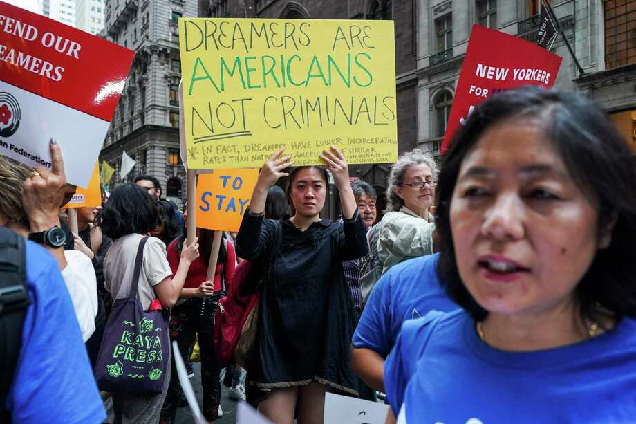 Protesters demonstrate against President Donald Trump and in support of the Deferred Action for Childhood Arrivals (DACA), also known as Dream Act, near the Trump Tower in New York. US federal judge John D. Bates, of the District of Columblia, ruled last week that last years revocation was illegal and the entire program could have to be restarted. Photo: JEWEL SAMAD /AFP /Getty Images / AFP or licensors